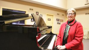 "Woodbury Community Foundation member Dixie Ewing sits at the grand piano -- once donated for use in the city's Central Park. It started with the piano, but we've got great things ahead,"" Ewing said of the Foundation. (Bulletin photo by Mathias Baden)"
